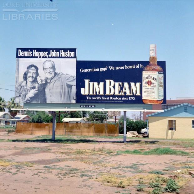Hopper_Bill board advertisement for Jim Beam whisky featuring Dennis Hopper and John Huston, 1972. Retrieved from Duke University Library.