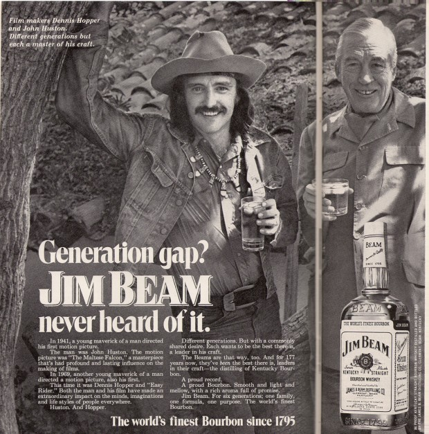 Hopper_Magazine advertisement on two pages for Jim Beam whisky featuring Dennis Hopper and John Huston, 1972, Retrieved from Flickr.