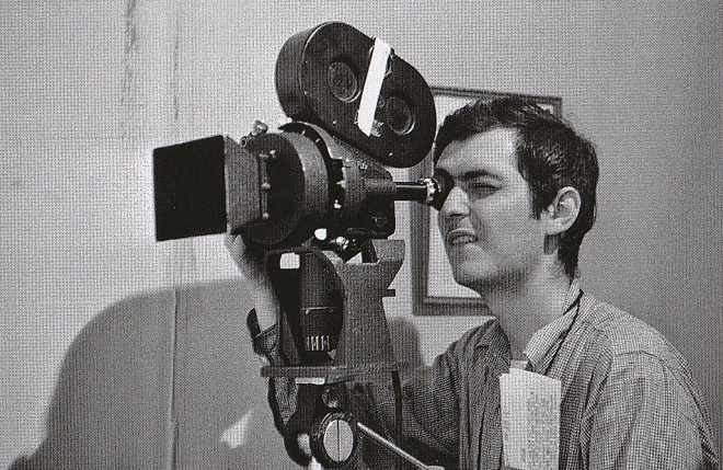 On the set of Killer's Kiss, framing a shot with an Arriflex.