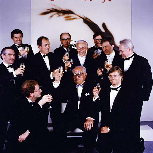 Directors Claude Lelouch, Bernardo Bertolucci, Paolo and Vittorio Taviani, Jacques Cousteau, Costa-Gavras, Andrzej Wajda, Martin Scorsese, Steven Soderbergh, and Bille August raise a glass to Akira Kurosawa at the 1990