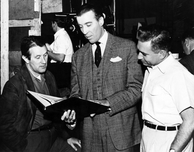 (Left to right) Director Freddie Francis, actor Christopher Lee, and producer Milton Subotsky going over the script during the shooting of the film Dr Terror's House of Horrors (1965).