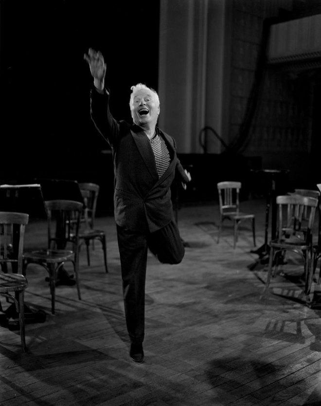 Emile Savitry. Charlie Chaplin posing for a film poster, Paris, 1949.