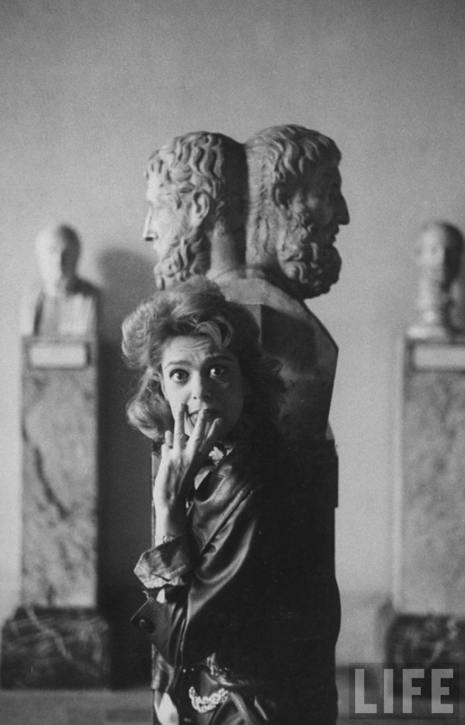 MM Standing in Front of Bust of Janus, at Louvre
