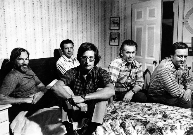 Special effects technician Marcel Vercoutere (far left) shares a relaxing moment with his crew and director William Friedkin on the set of The Exorcist.