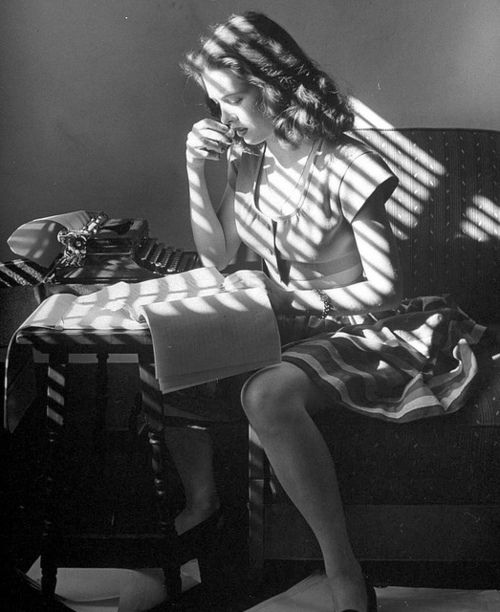 Actress Cathy O'Donnell working on her poetry, 1945, photo by Martha Holme