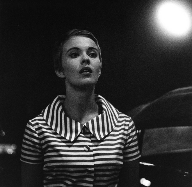 Jean Seberg during the filming of a night scene on the Boulevard Saint Germain (A Bout De Souffle), 1959