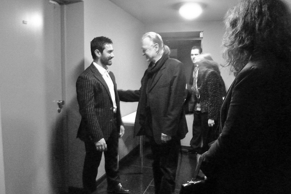 Béla Tarr,warmly greets Bollywood superstar and International Jury Member Aamir Khan, backstage, after winning his Jury Grand Prix Award.