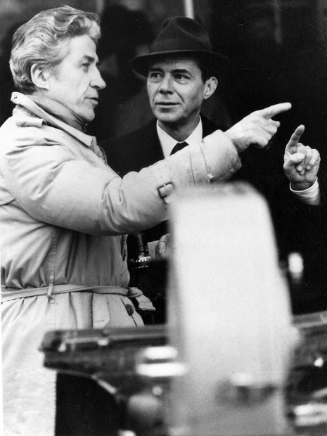 Director Alain Resnais and Dirk Bogarde exchange ideas on the set of Providence
