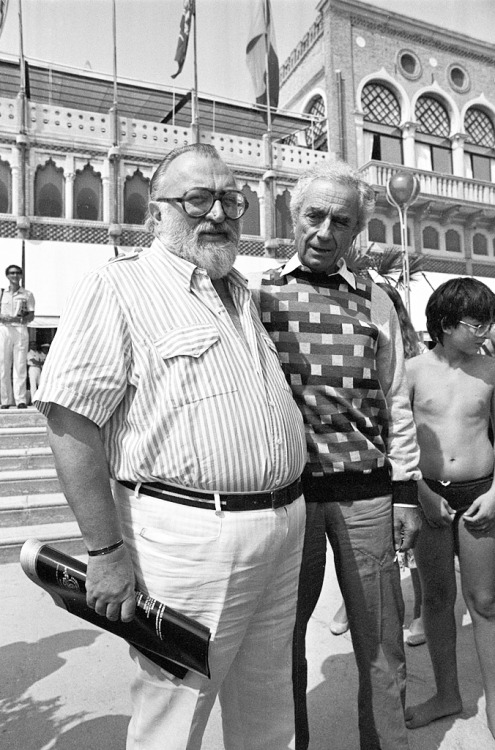 Sergio Leone with Michelangelo Antonioni outside the Excelsior hotel, Lido, Venice, 1984.-1
