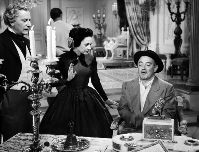 Anton Walbrook and Martine Carol listen to director Max Ophüls on the set of Lola Montès, 1955