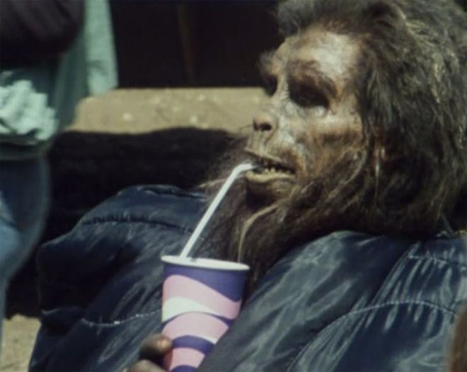 An apeman takes a break during the shooting of Jean-Jacques Annaud's Quest for Fire (1981)