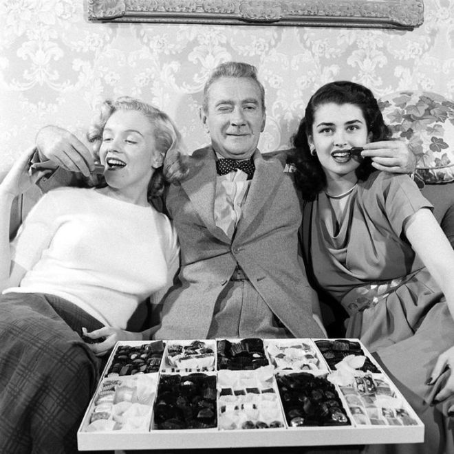 Marilyn Monroe at the age of 21, with Clifton Webb and Laurette Luez on the set of the 1948 comedy, Sitting Pretty