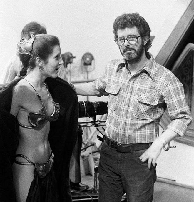Carrie Fisher and George Lucas on the set of Return of the Jedi.
