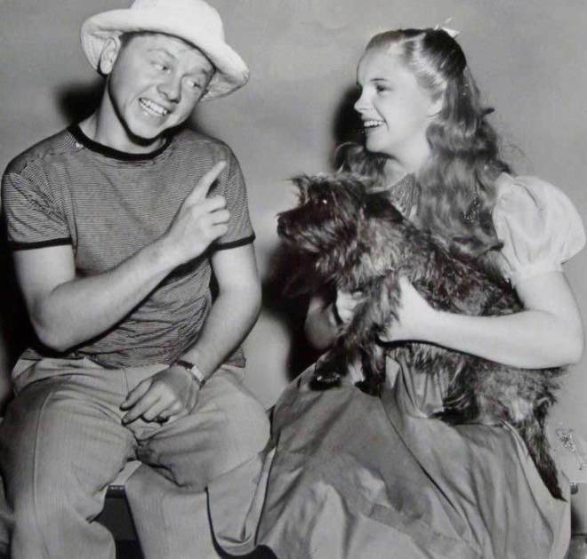Mickey Rooney visiting Judy Garland and the dog Terry on the set of The Wizard Of Oz.