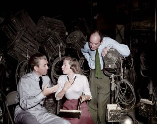26TH_STRATEGIC AIR COMMAND (1955) - James Stewart & June Allyson discuss a scene while director Anthony Mann listens closely - Production Still.