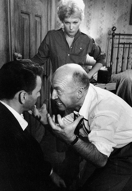 Director Otto Preminger demonstrates what he wants from Kim Novak and Frank Sinatra on the set of The Man with the Golden Arm.