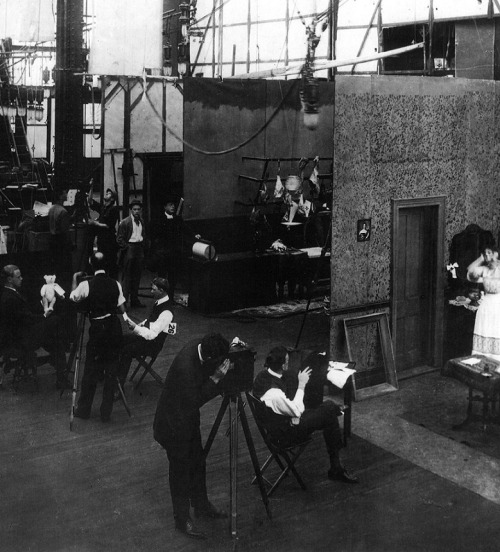 19th_EDISON STUDIOS - 1907-1914-A silent film studio in action - relatively simple, three-sided sets could be built side by side to make maximum use of the space, with two or more films shooting simultaneously.