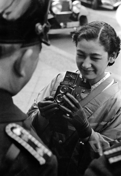 5th_Setsuko Hara is photographing a policeman with her Rolleiflex camera during her visit to Berlin, Nazi Germany, 1937. She was there to promote the film  Daughter of the Samurai (1937) - a co-production between Japan