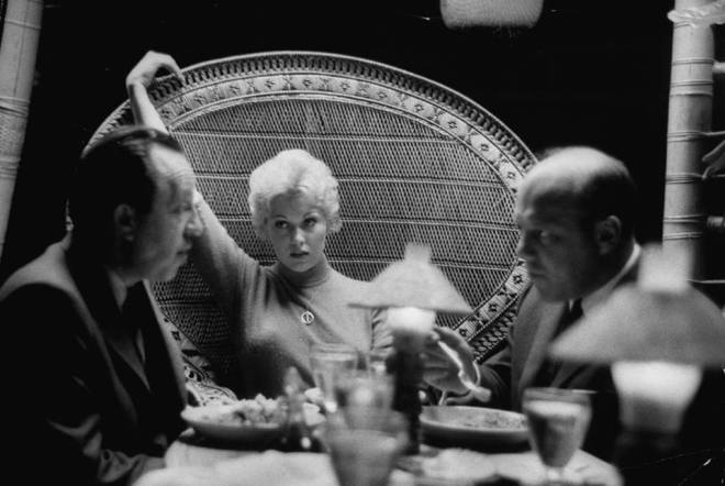 19_Kim Novak and agents Al and Wilt Melnick by Leonard McCombe, 1956.jpg