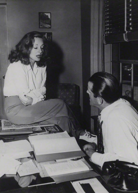 10_Tallulah Bankhead on the desk of Hector Dods talks over Lifeboat, 1944..jpg