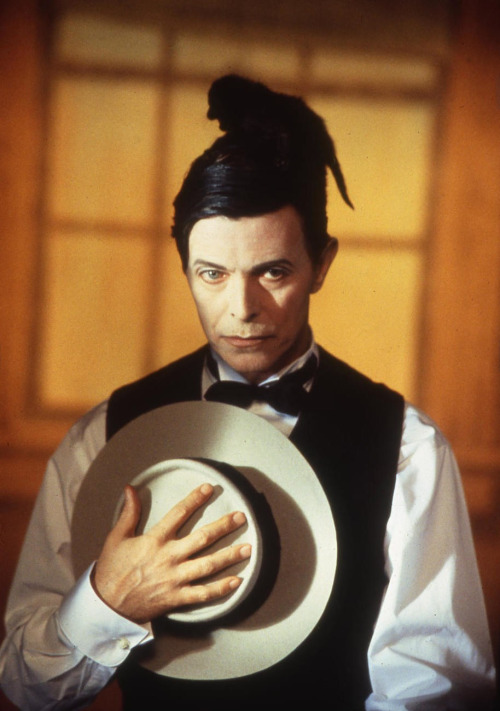 28_David Bowie impersonates Buster Keaton with a cat on the set of Miracle Goodnight video, 1993, photo by Jeffrey Mayer.jpg