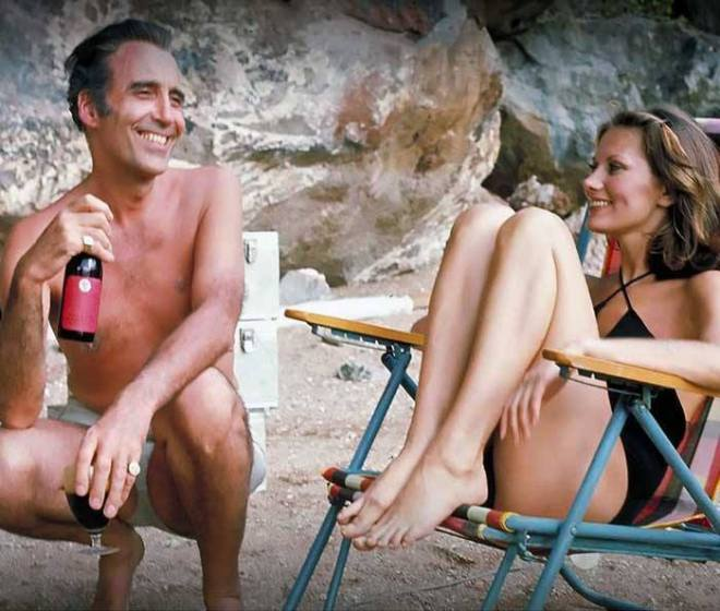 9_Christopher Lee and Maud Adams on the set of The Man with the Golden Gun.
