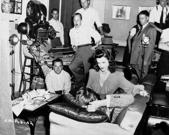 14_Director Jacques Tourneur (seated on the floor under the camera) and Simone Simon on the set of Cat People,1942..jpg