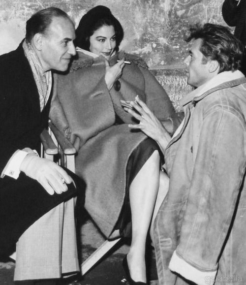 Ava Gardner with hairdresser Sydney Guilaroff and Dirk Bogarde on the set of The Angel Wore Red, 1960.jpg