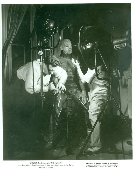 Director Karl Freund and makeup artist Jack Pierce attending to Boris Karloff's full-body costume in THE MUMMY.jpg