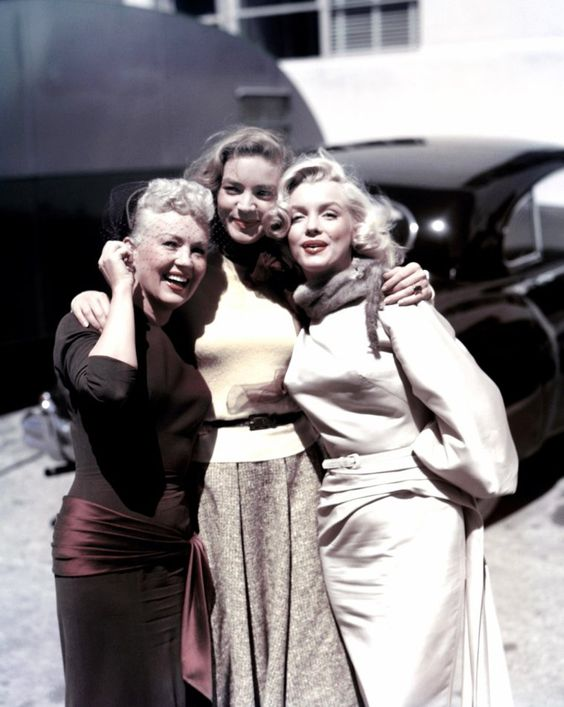 Betty Grabble, Lauren Bacall and Marilyn Monroe on the set of How to Marry a Millionaire directed by Jean Negulesco, 1953.jpg
