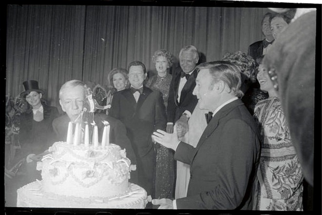22_Fred Astaire blowing out the candles on his 77th birthday, 1976.jpg