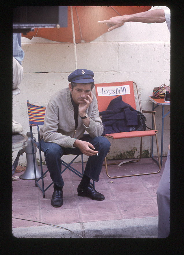 "15_Jacques Demy on the set of ""Les Demoiselles de Rochefort"" photographed by Agnès Varda.jpg"