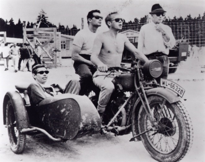 26_James Coburn, Steve McQueen, James Garner, and director John Sturges on the set of The Great Escape, 1962..jpg