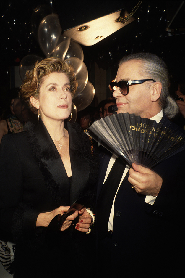 30_Catherine Deneuve and Karl Lagerfeld at the Fashion Week  party at Bains Douches, ca1990.  .jpg