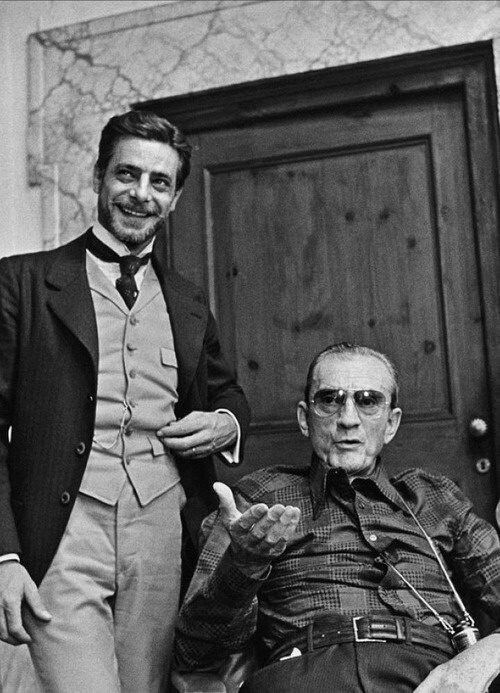 "Giancarlo Giannini and Luchino Visconti on the set of ""The Innocent"" (1976).jpg"