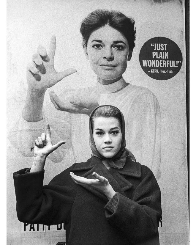 "27_Jane Fonda, then a student at the Lee Strasberg's Actors Studio, in front of the poster of Anne Bancroft for ""The Miracle Worker"". New York, 1960, photographed by Paul Slade.jpg"