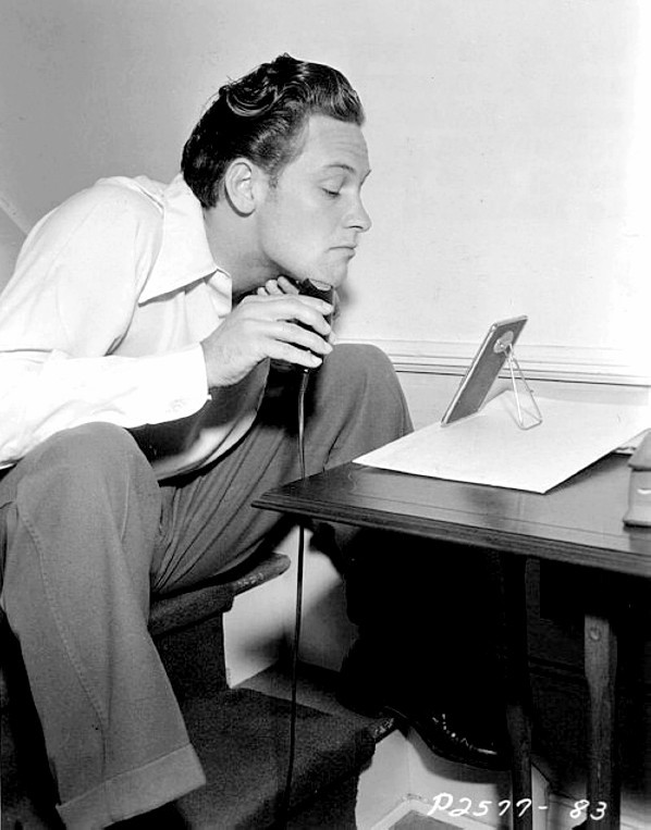 19_Young William Holden shaving on the set of Golden Boy, his film debut, 1939..jpg