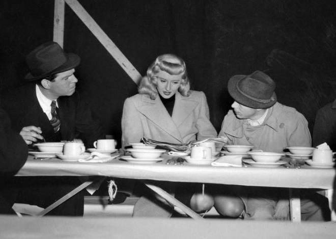 12_Fred McMurray, Barbara Stanwyck, and Billy Wilder on the set of Double Indemnity, 1944..jpg