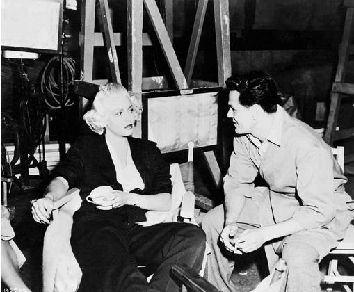behind-the-scenes photos taken during the shooting of The Postman Always Rings Twice (1946). Look for director Tay Garnett and stars Lana Turner, John Garfield, and Cecil Kellaway.-3