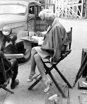 behind-the-scenes photos taken during the shooting of The Postman Always Rings Twice (1946). Look for director Tay Garnett and stars Lana Turner, John Garfield, and Cecil Kellaway.-6