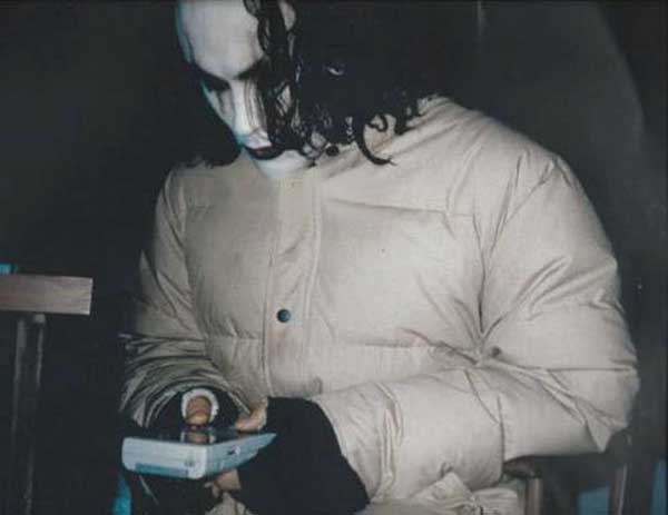 29_Brandon Lee playing Game Boy on the set of The Crow..jpg