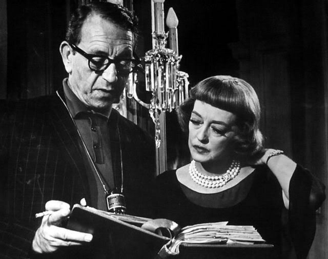 9_Director Paul Henreid and Bette Davis go over the script for Dead Ringer.jpg