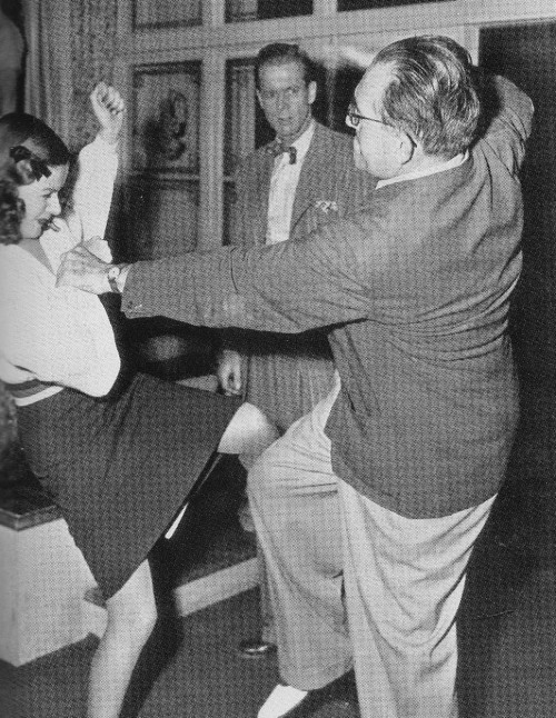 11_Director Fritz Lang demonstrates an assault sequence for Dan Dureya on the set of Scarlet Street.jpg