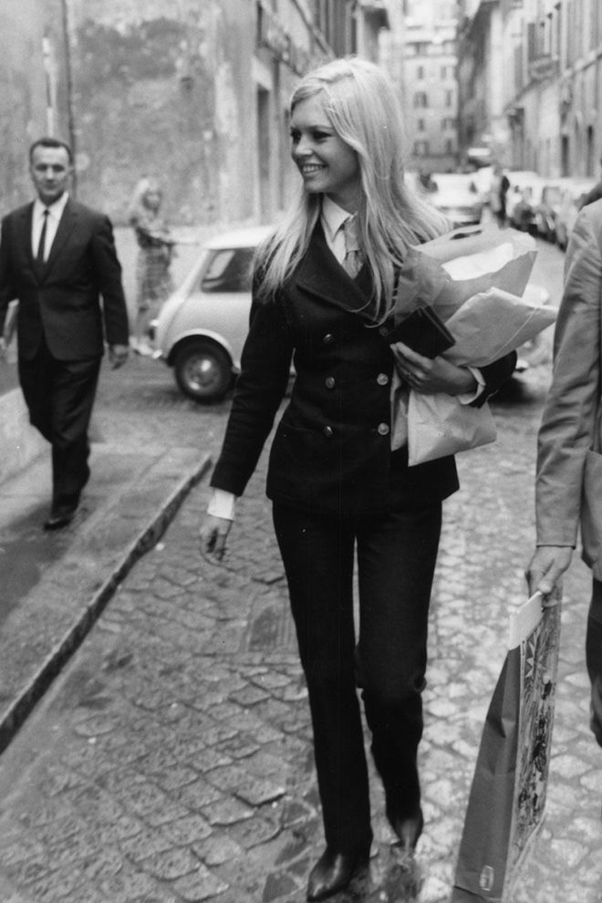 28_Brigitte Bardot goes shopping in the Via Margutta in Rome in 1961 wearing a sleek trouser suit..jpg