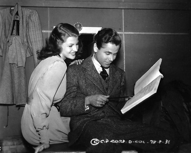 31_Rita Hayworth and Glenn Ford behind the scenes of The Lady in Question, 1940.jpg