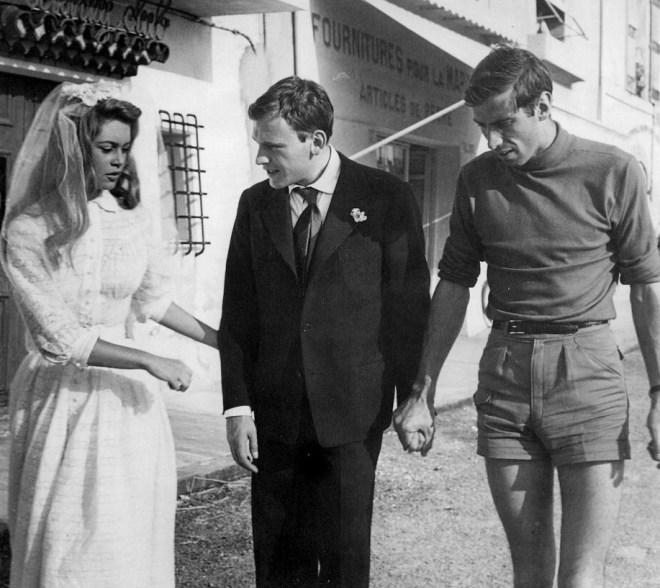 31_Brigitte Bardot, Jean-Louis Trintignant and Roger Vadim on the set of And God Created Woman, 1956.jpg