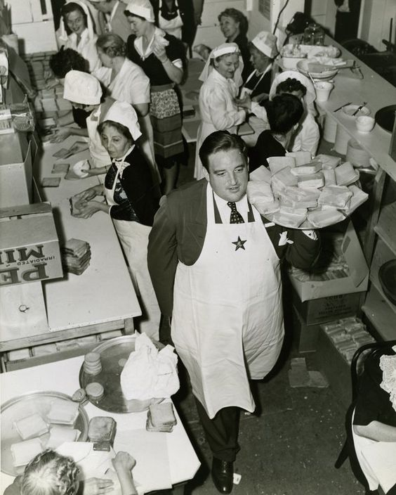Actor, Laird Cregar Carries A Tray Of Sandwiches For The Servicemen At The Hollywood Canteen.jpg