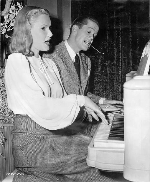 25_Actress June Vincent and actor Dan Duryea having fun on the set of Black Angel (1946)..jpg