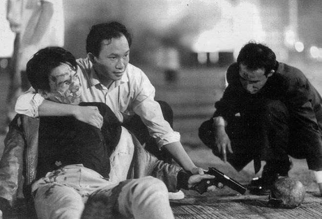13_John Woo directs Tony Leung Chiu-wai and Waise Lee on the set of Bullet in the Head.jpg