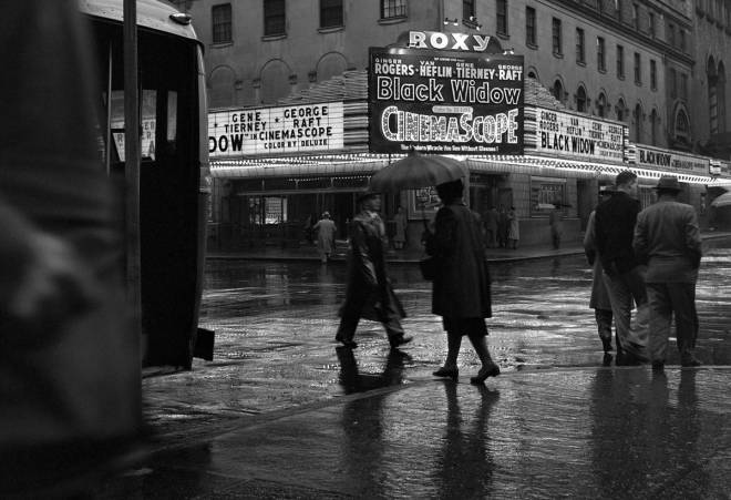 "3_A rainy evening in Times Square under the neon lights of the ""Black Widow"" marquee, Manhattan, 1954. .jpg"